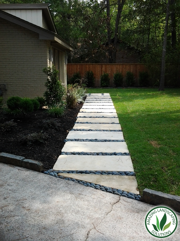 stone pavers path through grass
