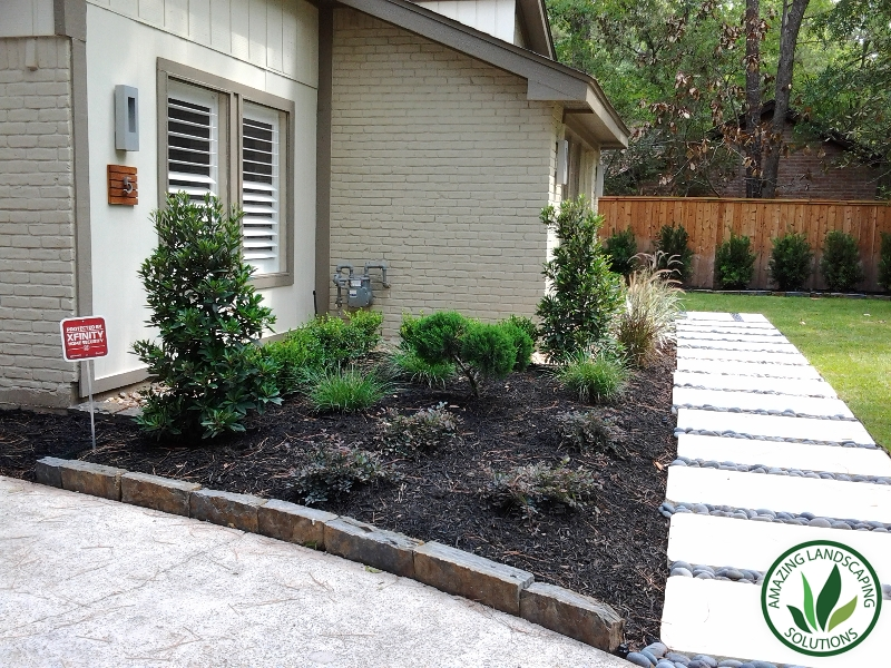 mulch and bushes in The Woodlands, TX