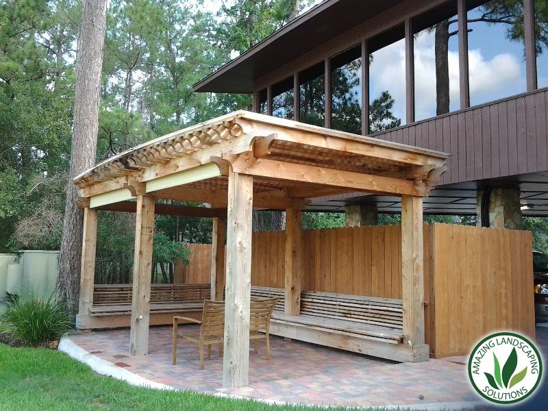 wooden patio through grass