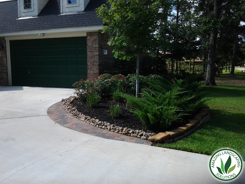 landscaped driveway  through mulch, plants and grasses