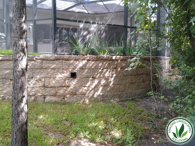 stone brick walled lawn grass with drainage