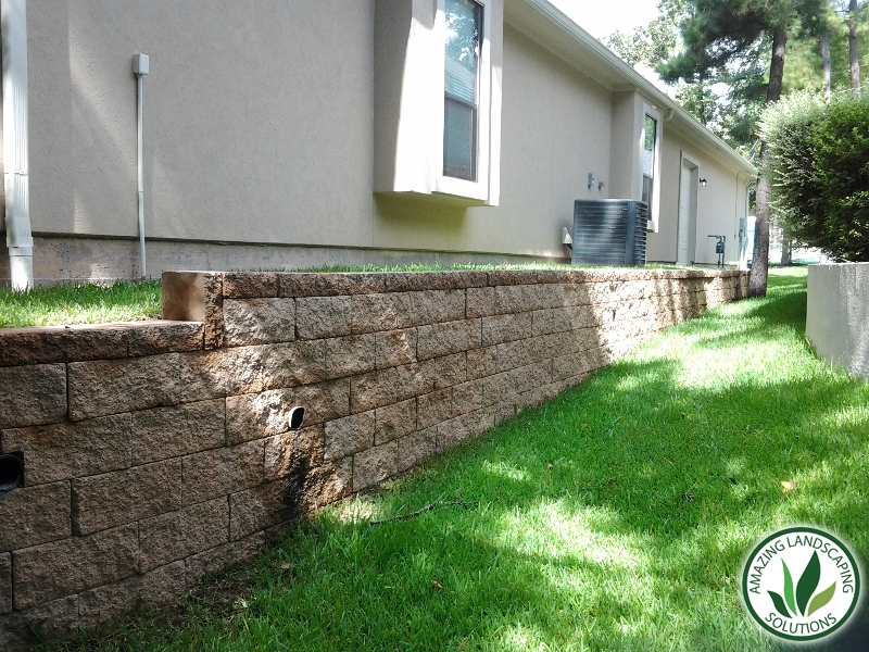 backyard stone bricked lawn grass