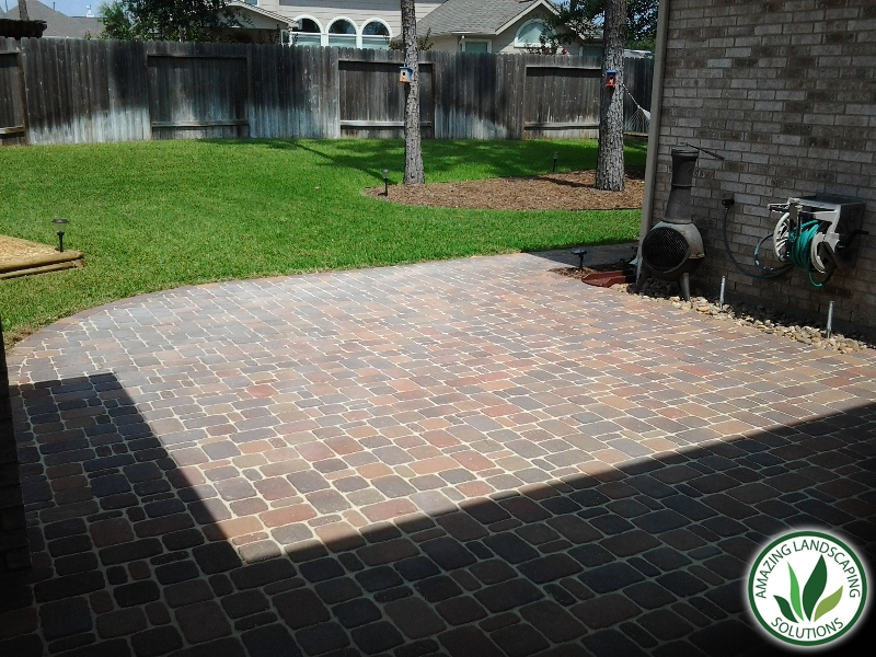 bricked patios with backyards eco-friendly trees and wooden wall