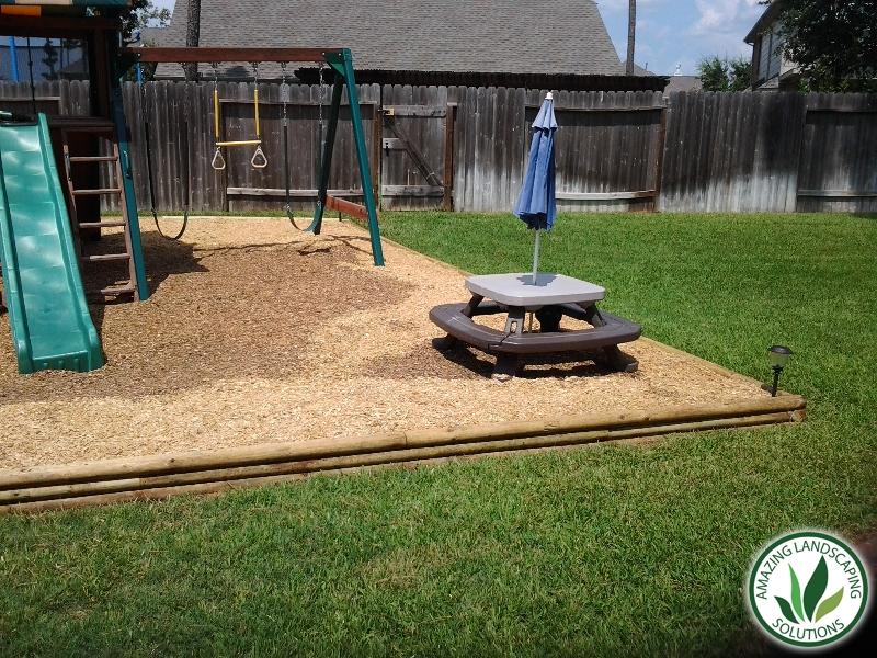 backyard playground landscape in El Paso, TX