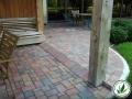 stone brick patio with wood post
