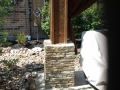 Brick stone column with river stones landscape