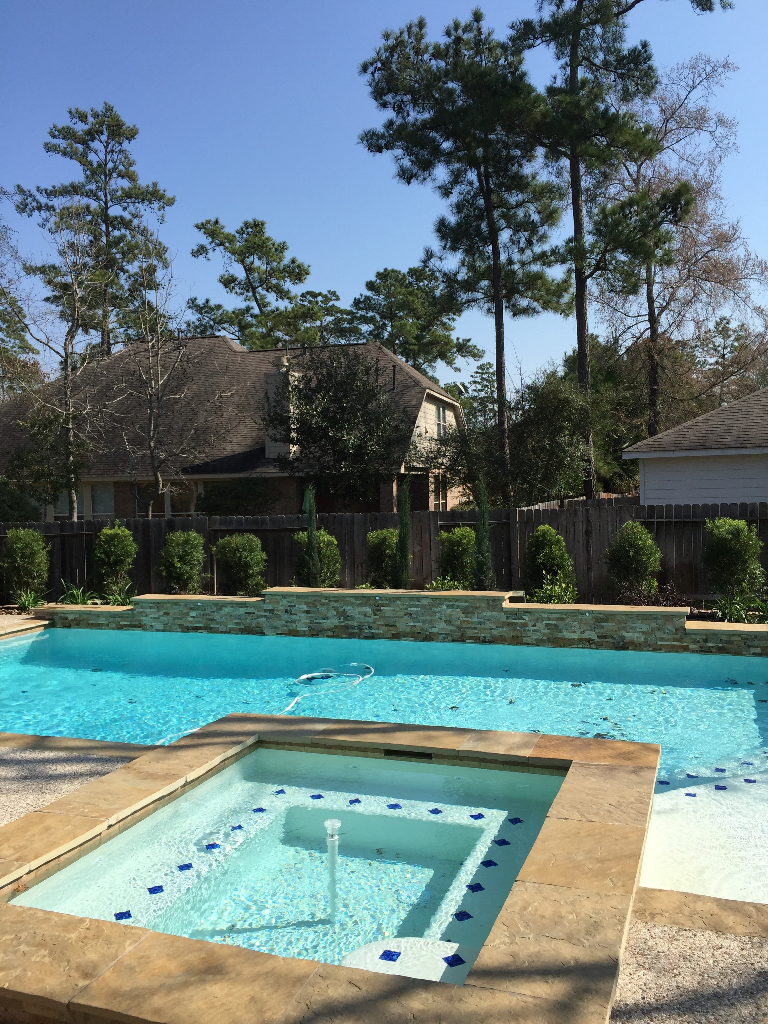 Pool Landscaping With Retaining Wall