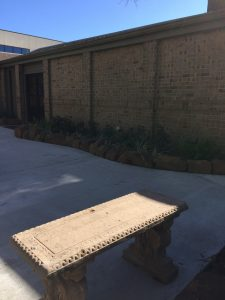 flastone walkway and bricked wall with stone bench in Brownsville, TX