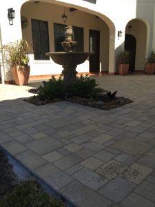 Stone brick patio with fountain in Montgomery, TX