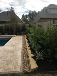 bed along pool deck in the Woodlands, TX