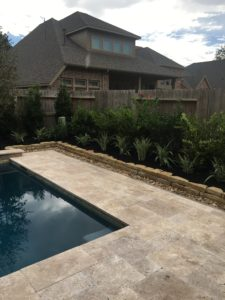 Pool deck with crushed river stones in the Woodlands, TX